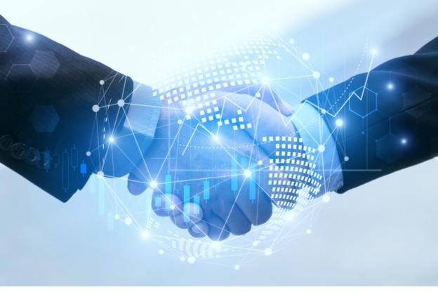 two men shaking hands in partnership