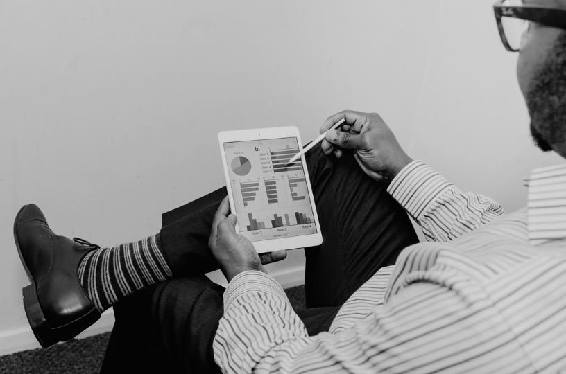 Man Reviewing Analytics on iPad